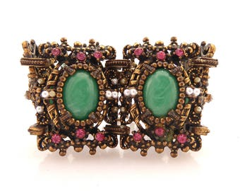 1950s Unsigned Selro Selini heavy ornate brass Victorian revival green lucite cabochons, pink rhinestones, and faux pearl statement bracelet