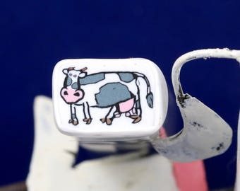 Raw uncured Cow polymer clay cane