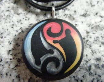 Tribal Yin Yang  Fire and Ice hand carved on a polymer clay black color background. Pendant comes with a FREE necklace