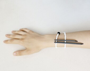 minimal tribal bracelet with black sticks and white beads, contemporary jewelry