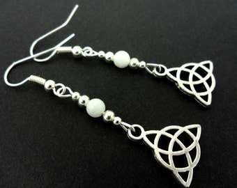 A pair of tibetan silver & white jade bead celtic knot dangly earrings. new.