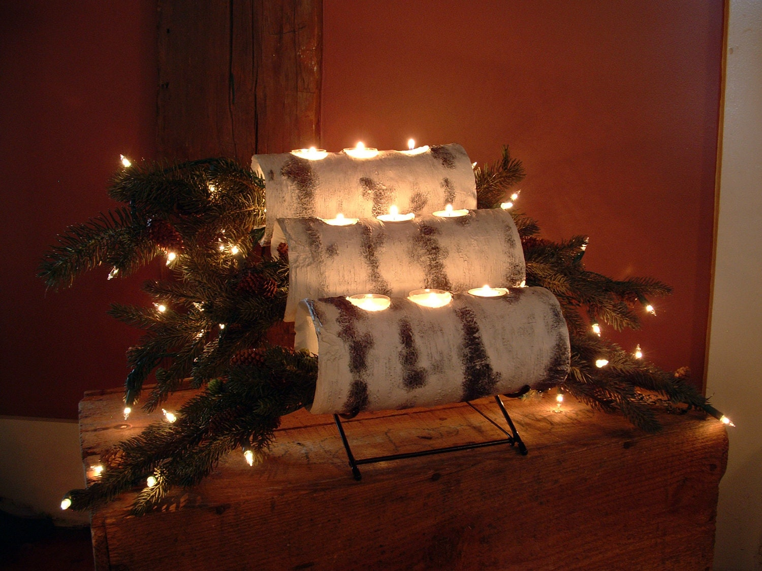 Three tier birch Yule log cradle with birch logs and prelit evergreen boughs are right at home in the fireplace. Add a warm touch to your fireplace in the off season or on those nights when you just wan to cozy up the room a little. All of my birch pieces are made of plaster cast in