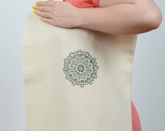 Embroidered green mandala on neutral tote bag. Usable embroidery design