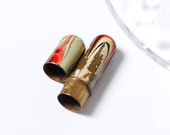 Antique brass needle holder embellished with enamel