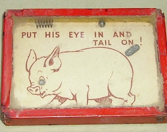 Pig dexterity puzzle Put his eye in and tail on! English
