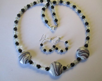 Fancy black & crystal beaded necklace with matching pierced earrings - # 549