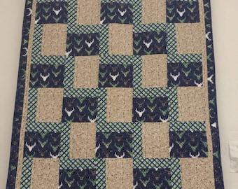 Deer and arrow quilt