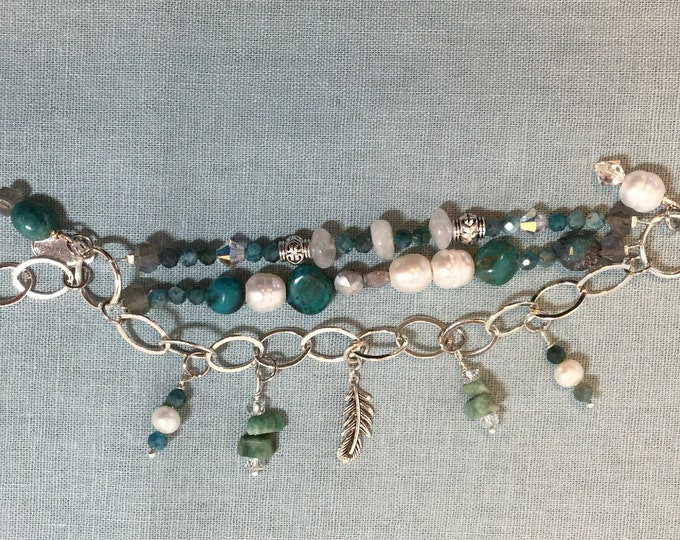 Triple strand charm bracelet with African turquoise, moonstone, appatite, and pearls