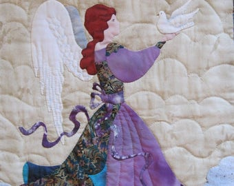 """Angel of Peace, Quilted Wall Hanging, completed, signed original by Bonnie L. Kaster, 1993, 22.5"""" X 34.5"""", purple and teal, angel with dove"""