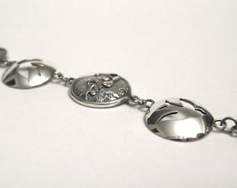 Bracelet with birds and textures in sterling silver