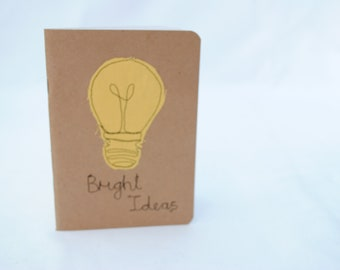 A6 notebook/sketchbook with homemade machine embroidery textile design felt Cheerful yellow Bright ideas lightbulb perfect for notes