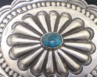Vintage Southwestern Navajo silver concha pin with turquoise center