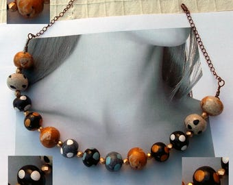 Short necklace with polymer clay beads with polka dots, beige, black, gold, grey and light blue