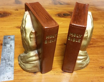 Praying hands book ends.