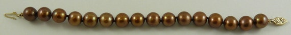 Freshwater Chocolate Pearl Bracelet with 14k Yellow Gold Fish Lock 7 Inches