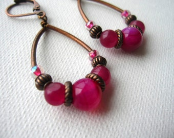 Pink beaded teardrop earrings with copper metal tubes and accents