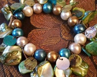 Shell design stretch bracelet, greens and blues, iridescent