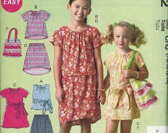 McCalls 6882 Girls' dress or top with gathered neckline with/out sleeves sash elastic waist skirt and frilled bag Size 7-8-10-12-14 uncut