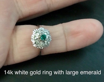 14k white gold ring with large emerald.  Classic 1920s look.