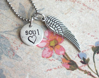 Soul Angel . Angel Wing and Mini Disc . Antiqued pendant details, silver plated . embossed metal design . Add to your order at Tipsy Whimsey