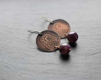 Dangle earrings with hypoallergenic titanium earwires: featuring etched owls on 22mm copper discs with 10mm dark amethyst beads