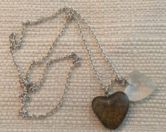 Two Glass Hearts Together on a Silver Chain