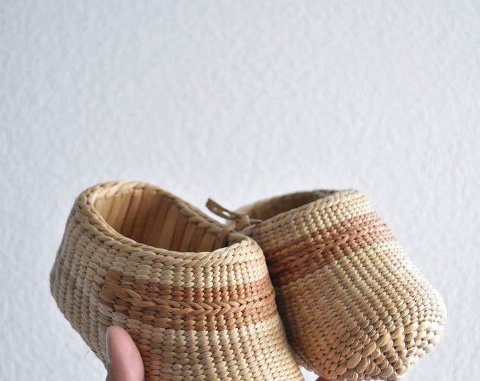 pair of woven straw baby shoes