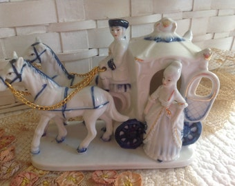 Antique Marie Antoinette by her blue and white horse drawn carriage