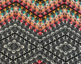 Abstract print on a poly rayon blend stretch knit fabric