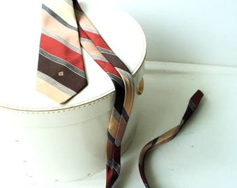Classy vintage 80s, polyester,  earth multicolor stripes necktie. Made by Givenchy, Paris.