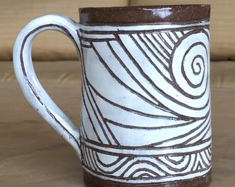 Stoneware coffee mug with sgraffito design