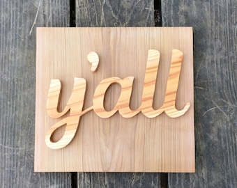 Y'ALL sign made from cedar treehouse scraps