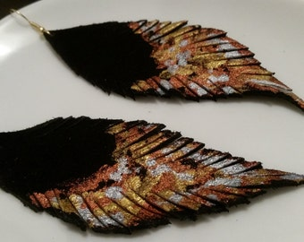 Handcrafted and hand painted suede leather feather earrings. Available to order customized colors.