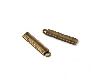Set of 2 small charms ruler color bronze