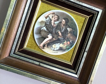 Framed Ceramic Plaque Mounted on Velvet. Round Ceramic Plaque Depicting Children Playing in Gilded Wooden Frame. ROP00672