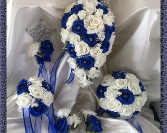Royal Blue & Ivory wedding bouquets with butterflies, Brides, Bridesmaids, Flowergirls etc