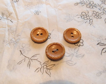 set of three vintage celluloid buttons