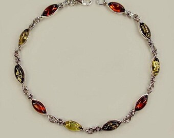Genuine Baltic amber oxidized sterling silver bracelet .
