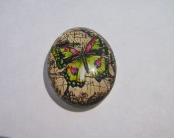 Glass cabochon oval 25 X 18 mm with a butterfly image yellow
