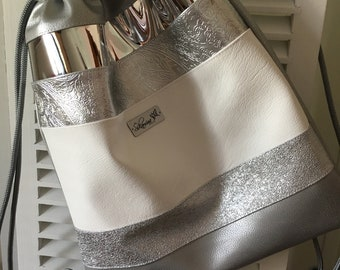 Drawstring backpack silver and white