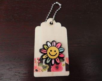 Wooden label floral theme measuring 7 x 4 cm