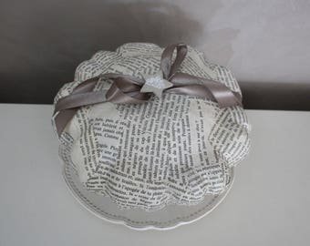 Genuine pattypan dried and decorated with pages from old book