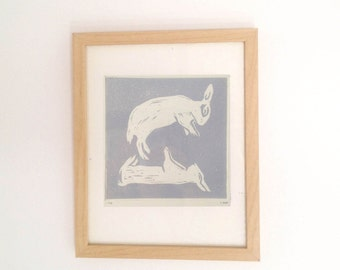 Dreaming Bunnies framed, hand pulled linocut, printed on German 300 GSM paper, limited edition of 45 in grey and white colourway