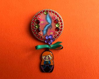 Russian doll and animal brooch