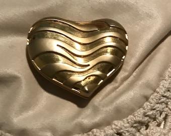 Vintage Estée Lauder solid perfume compact, heart shape with waves