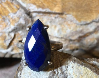 Faceted Lapis Lazuli on a four prong sterling silver setting  size 8