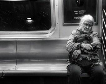 Woman resting on train