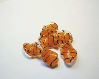 Orange lampwork twist beads