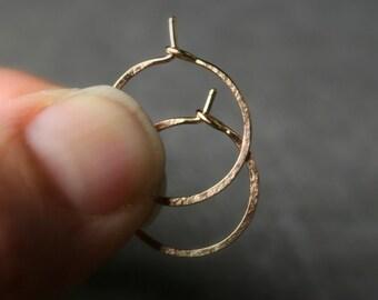Tiny 14 karat rose gold hammered hoops 1/2 inch