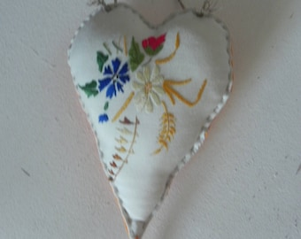 Embroidered flowers hang fabric heart
